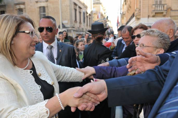 With the people: President of the Republic Marie Louise Coleiro Preca is however portrayed as being 'close to the business'